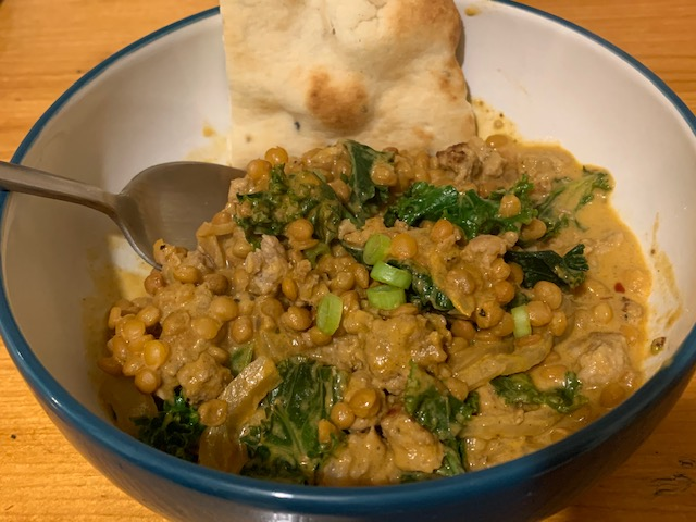Pork and lentil curry, with kale and naan bread