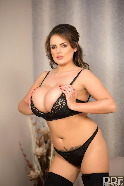 Katie Thornton squeezing big boobs black lingerie