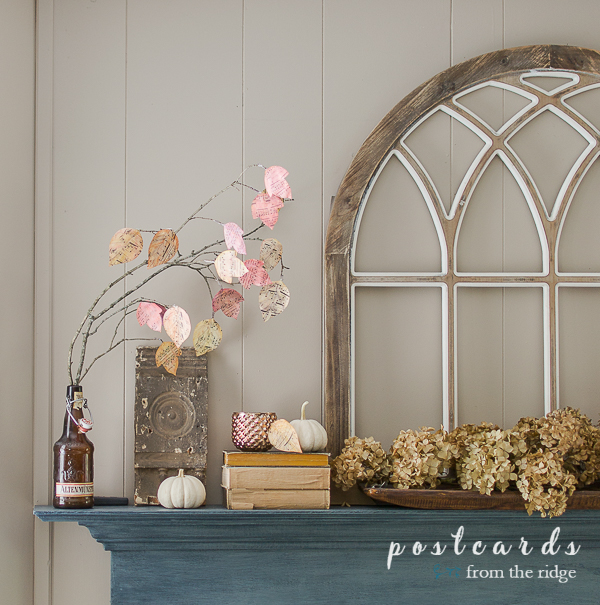 diy watercolor paper leaves with dried hydrangeas and cathedral window on fireplace mantel