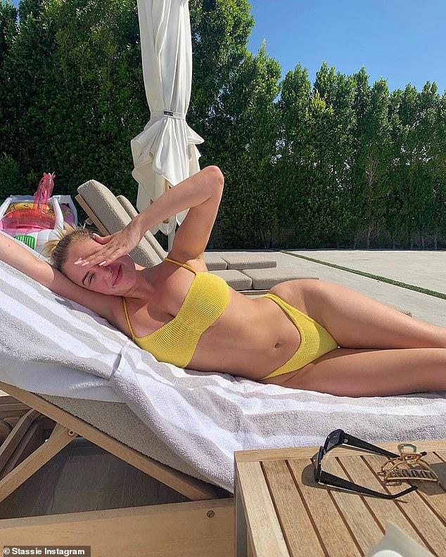 Kylie Jenner's friend Anastasia 'Stassie Baby' Karanikolaou poses in a bright yellow bikini