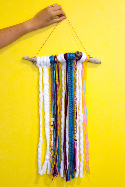 easy diy boho yarn wall hangings- super fun craft to make with the kids- all you need are sticks, yarn, and beads