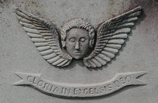 Winged face: 'The soul in flight'. Ipswich Cemetery, Queensland.
