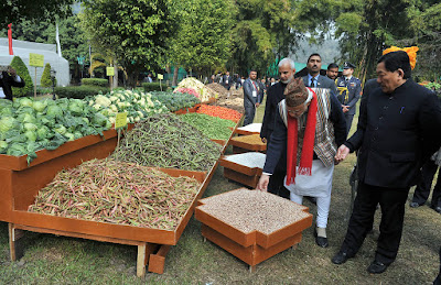 The Prime Minister, Shri Narendra Modi visiting the organic product exhibition, in Gangtok on January 19, 2016. .The Chief Minister of Sikkim, Shri Pawan Kumar Chamling is also seen..