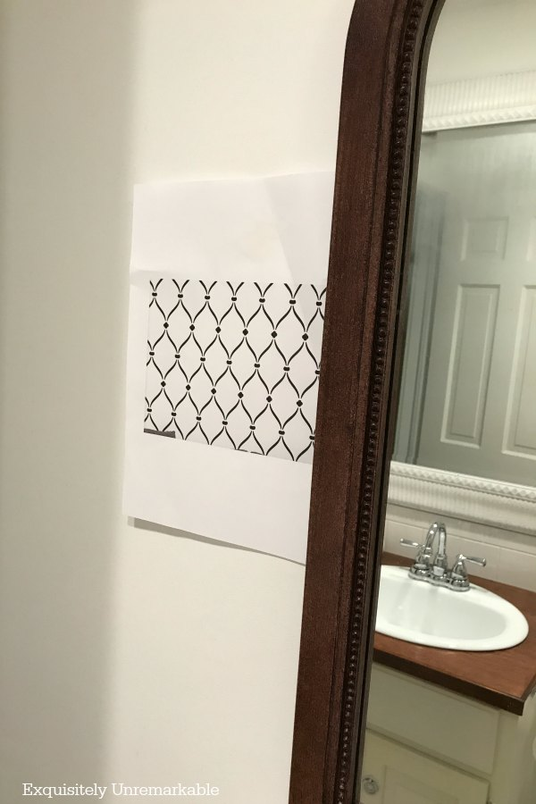 taped stencil pattern to wall