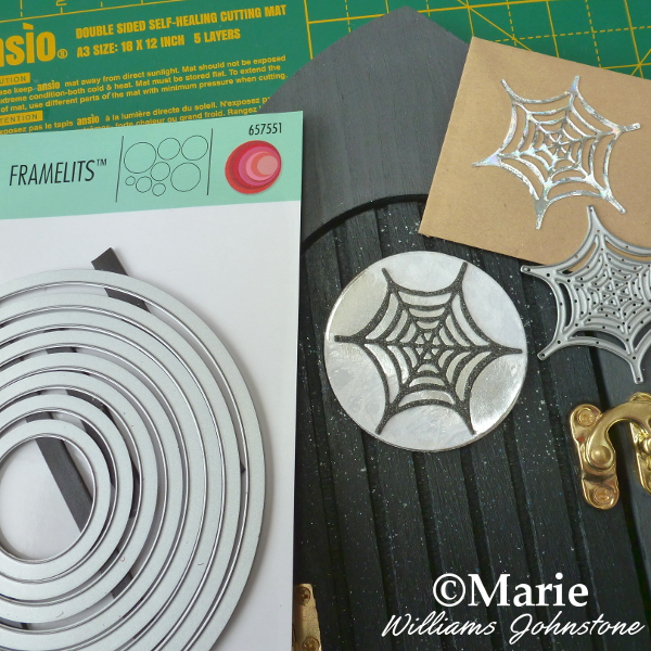 Adding a spiderweb window detail to the altered art wood door