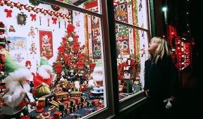 Child peers in window
