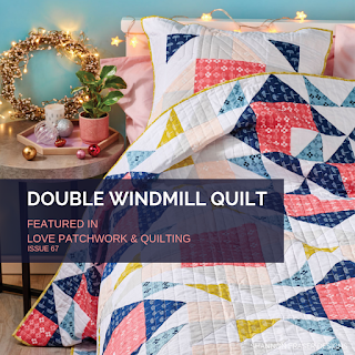 Double Windmill quilt on a bed | Shannon Fraser Designs