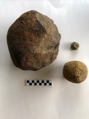 Diabase hammerstones: 19 pound medium-grained quarry boulder left, smaller Rossville Diabase pictured