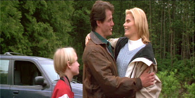 Mason Gamble, Michael Paré, and Mariel Hemingway in a movie still for the 1996 Halloween film Bad Moon