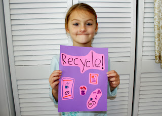 "You wouldn't know it from her ""smile,"" but Tessa had a blast designing her own conversation poster. She chose to remind people to recycle cans, paper, plastic and glass."