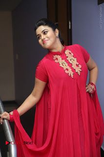Actress Poorna Latest Stills in Red Dress at Rakshasi First Look Launch  0216.JPG