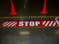 Polished concrete floor with stop sign embeffed in epoxy and urethane.