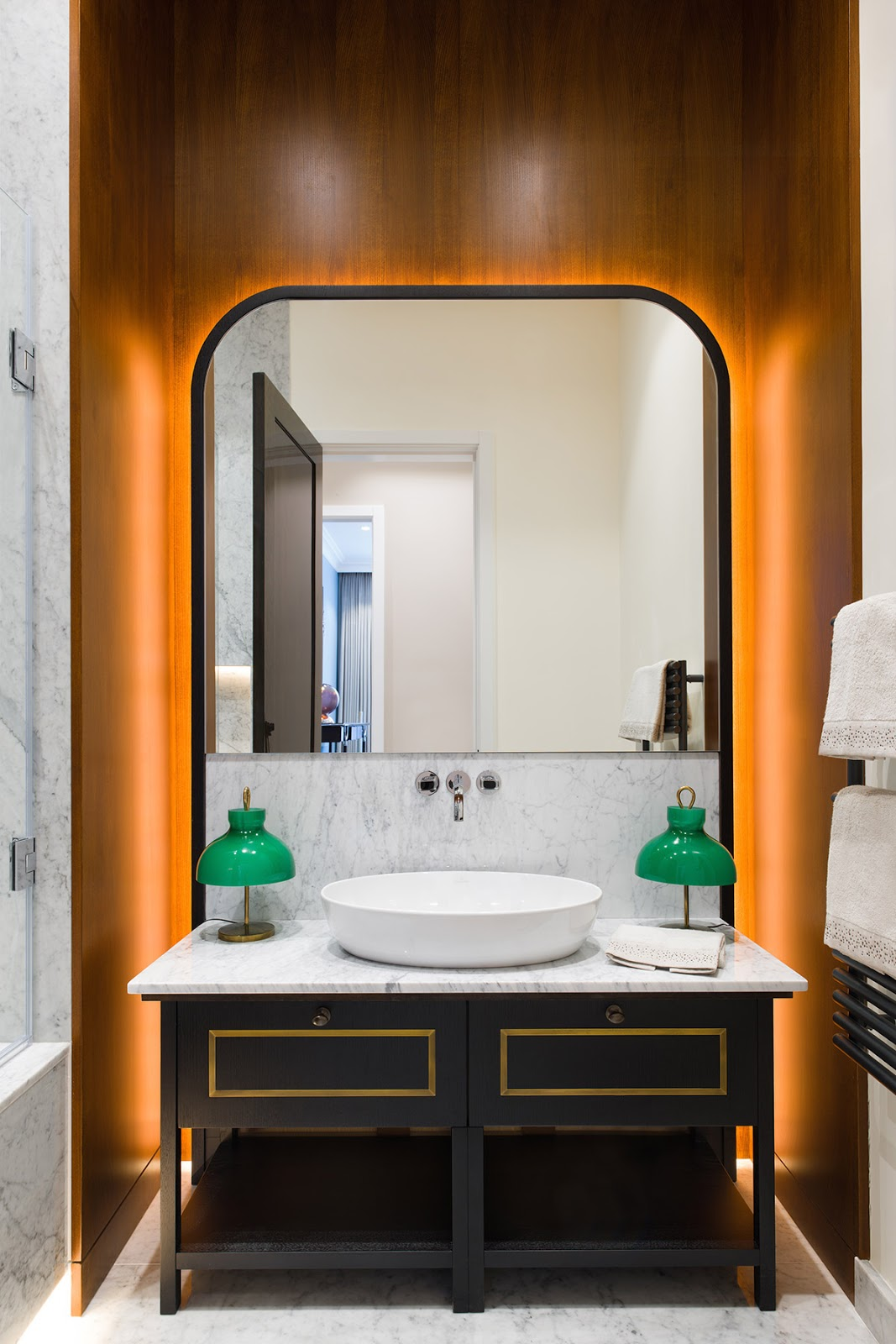 Bathroom with white marble and black furnitue