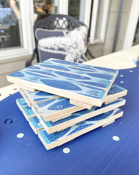 stack of wooden fish coasters