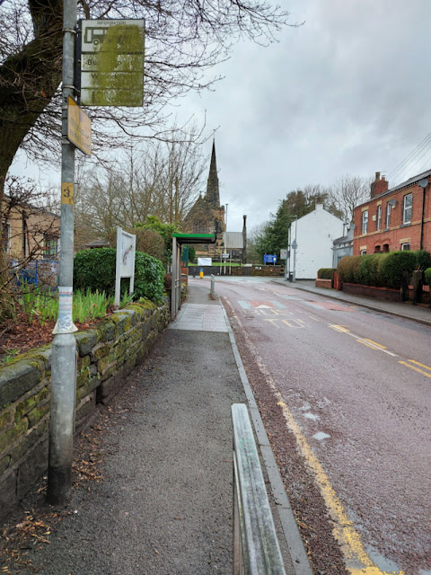 Looking up a deserted street towards a church