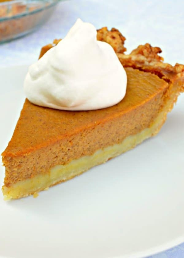 Easy Pumpkin Pie in a flaky crust with a dollop of whipped cream is a favorite! Homemade Pumpkin Pie made with Greek Yogurt to keep it rich and delicious. A must make Easy Pumpkin Pie recipe for Thanksgiving dessert  from Serena Bakes Simply From Scratch.