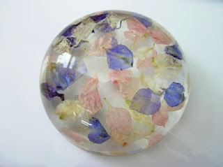 Wedding confetti preserved within a paperweight