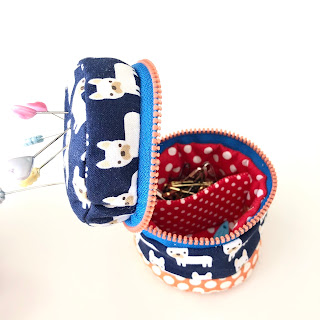 A cute zippered pin cushion made from scrap fabric made by CraftyRie.