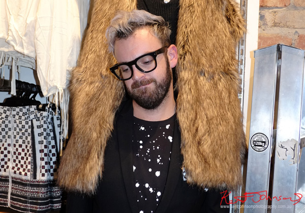 Trying on a faux fur, P.E. Nation Launch Party at General Pants.