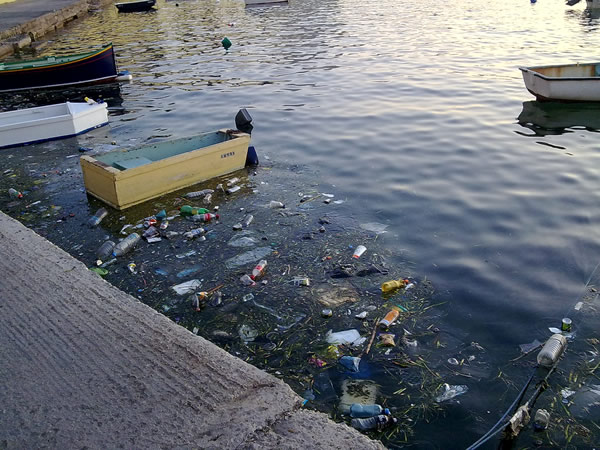 Municipal waste floating on the water