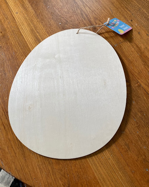 Photo of unpainted wooden Easter egg cutout