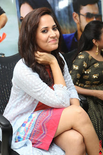 Actress Anasuya Bharadwaj in Orange Short Dress Glam Pics at Winner Movie Press Meet February 2017 (5).JPG