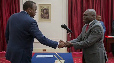 President Uhuru Kenyatta with Industrialization Principal Secretary Francis Owino. PHOTO | NMG