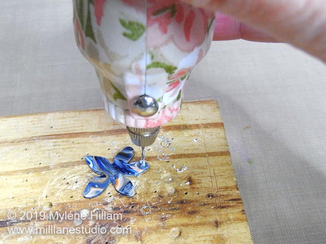 Drilling a hole in the tips of the resin petal