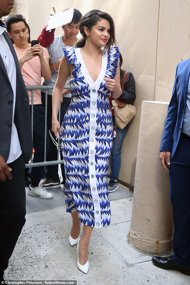 Selena Gomez looks lovely in a bright blue dress with ruffled sleeves