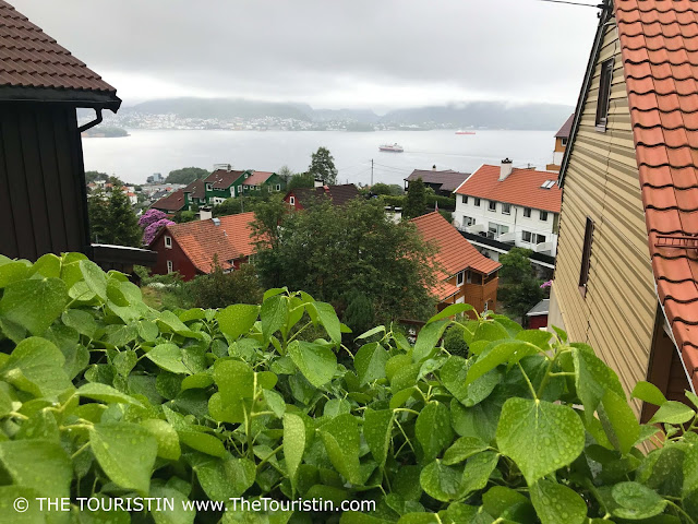 View over the rooftops towards a cruise ship in the harbour of Bergen in Norway.