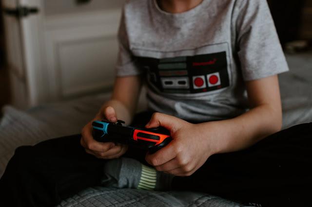 A boy playing on a Nintendo Switch