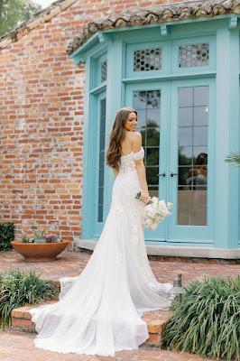 bride in front of blue door at casa feliz