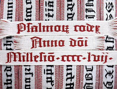 "Black, white and red tablet woven bands that read ""Psalmorum codex Anno domini 1457"""