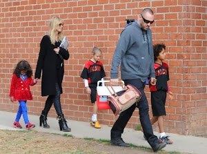 Heidi Klum with a family on football