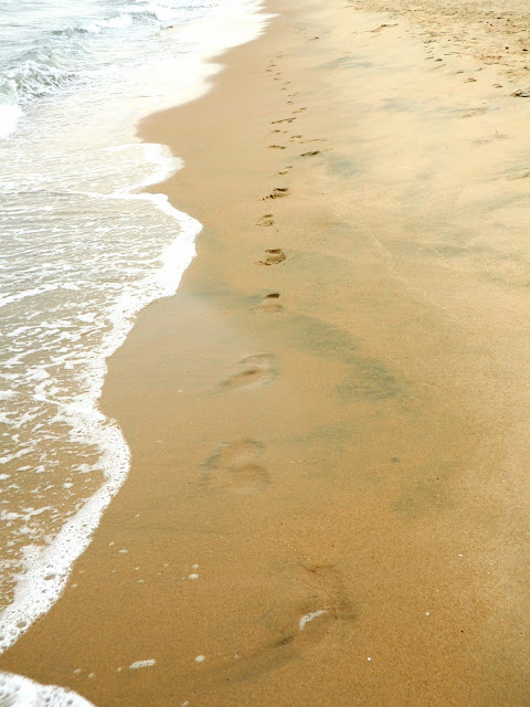 Footprints in the sand on Cheung Sha beach, Lantau Island, Hong Kong