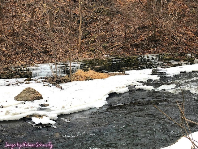 Rock ledges and icicles frame the Menomonee River.