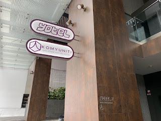 Signs for YOTEL and Komyuniti