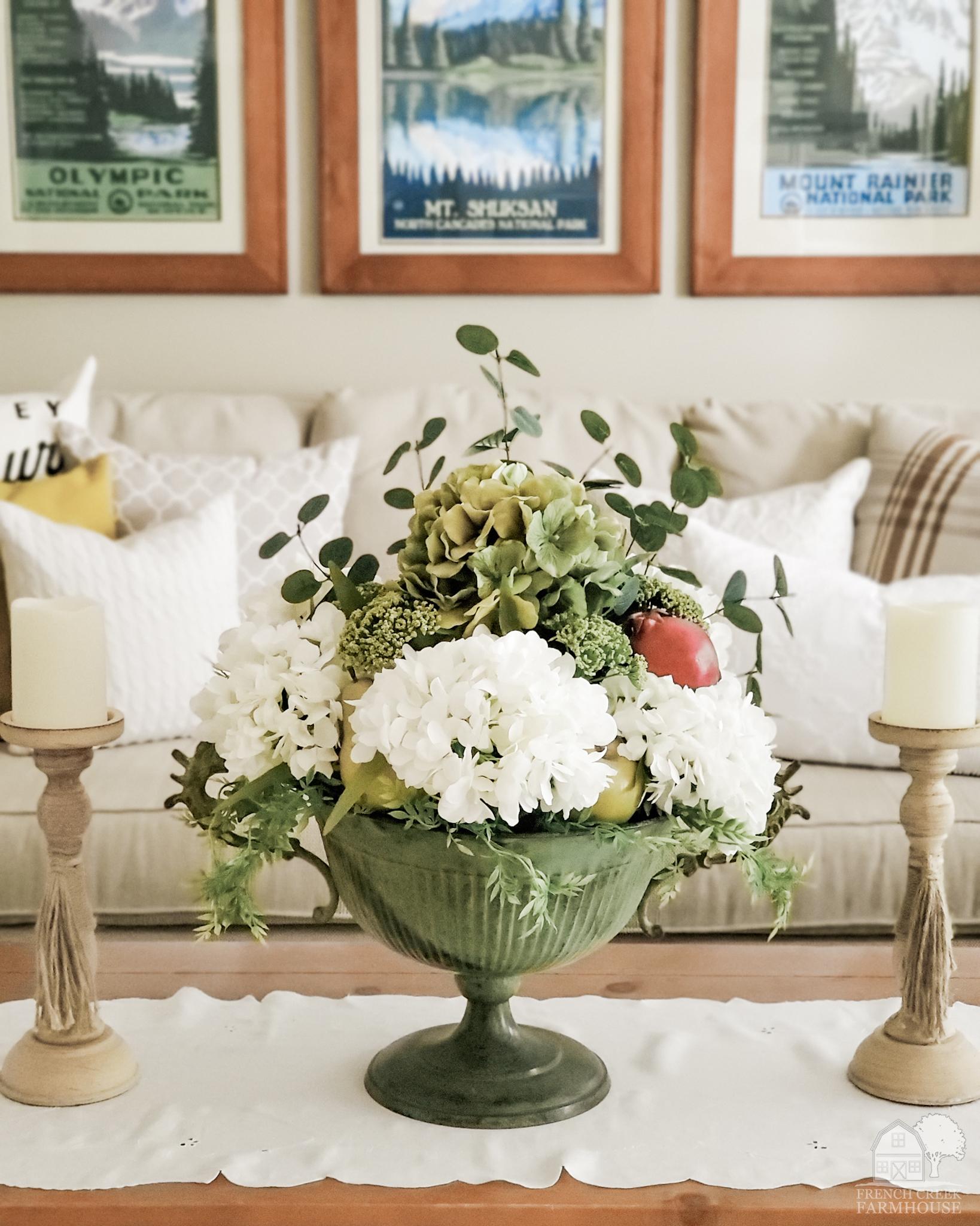 Creamy hydrangeas fill a vintage pedestal bowl