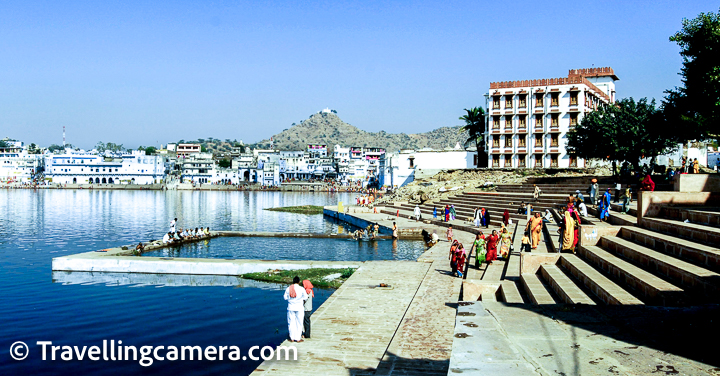 Walk around the ghats of Pushkar Lake :   By now you must have realised that Travellingcamera team loves walking and we love sharing about walks you can do at a place. Around the Pushkar lake, there are 52 bathing ghats. We will talk about precautions around this later but these ghats are beautiful places around the lake to get a vibe of the place and how seriously some of the religious activities take place around the lake. This is also a place where we meet scammers, so be alert and don't miss our section in the bottom of the post to  know about things you need to be aware about and avoid, when in Pushkar. Some of the ghats are more significant than others, like other religious places in India. Mahatma Gandhi's ashes were scattered on Gandhi Ghat it seems and Brahma Ghat marks the spot where Brahma is said to have worshipped. There is a also a belief that taking a dip in Pushkar Lake leads to salvation. Pushkar is one of the top holiest centres of pilgrimage for Hindus.