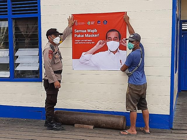 Polsek Murung Sosialisasikan Prokes Dan Pemasangan Spanduk Presiden RI Tentang Wajib Pakai Masker