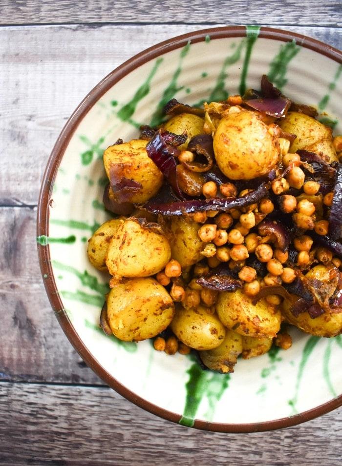 Balti potatoes in a ceramic bowl