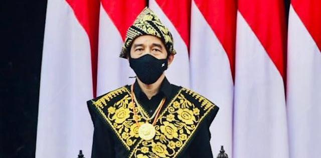 Jangan Sampai Aksi Jokowi Pakai Baju Adat Digugurkan Kasus Effendi Buhing