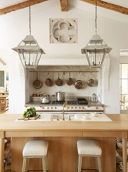 Cream Lacanche range in elegant #FrenchCountry kitchen with #rusticdecor and European antiques. #PatinaFarm
