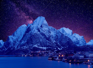Reine fishing village at night with starry sky, Norway