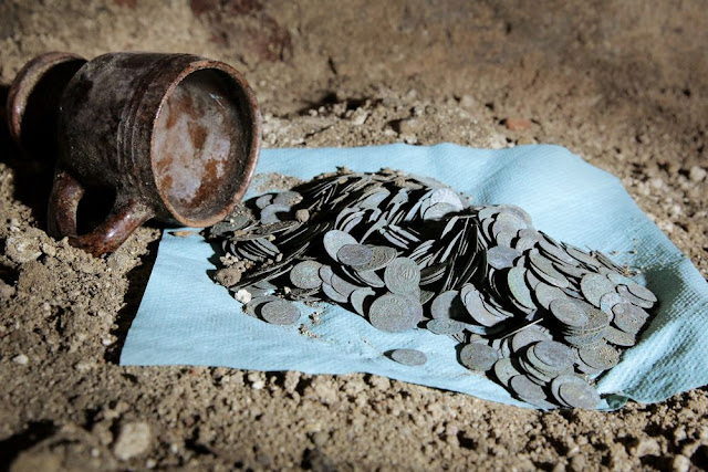 Thousands of 17th century silver coins found buried in Teutonic Knights' church