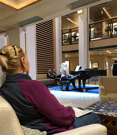 Enjoying piano by Aleksandra in the Atrium aboard the Viking Sky (Source: Palmia Observatory)