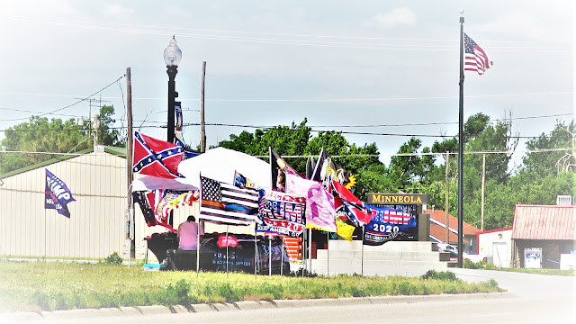 Trump and Confederate flags fly together forever. Minneola, Kansas. June 2020.