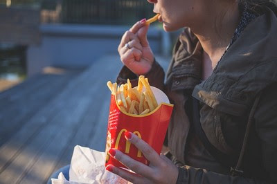 A person eating French fries can cause belly fat