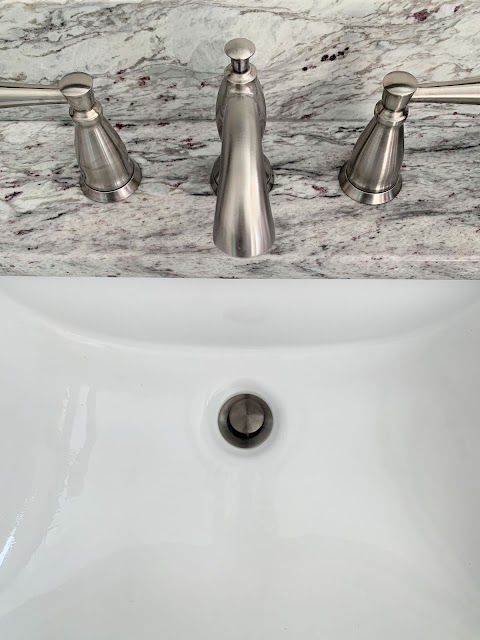 brushed stainless faucet white bathroom sink