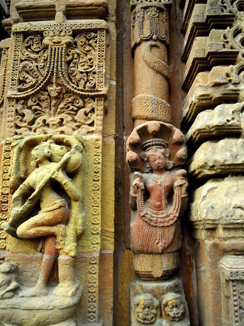 A Naga welcoming visitors with garlands, Mukteshwar Temple, Bhubaneshwar